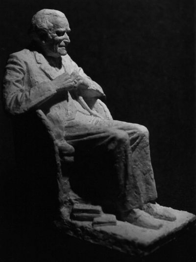 Sir Geoffrey Keynes seated